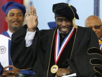 Combs waves to the crowd before his commencement address during 2014 graduation ceremonies at Howard University in Washington