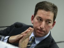 Greenwald testifies before a Brazilian Congressional committee on NSA's surveillance programs, in Brasilia