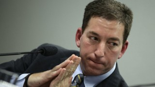 Greenwald testifies before a Brazilian Congressional committee on NSA's surveillance programs, in Brasilia