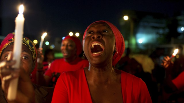 A woman shouts during a vigil in Abuja calling for the release of Nigerian schoolgirls abducted in Chibok