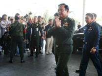 Thai Army chief General Prayuth Chan-ocha arrives to give a news conference at the Army Club in Bangkok