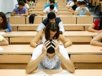 Students take a university entrance examination at a lecture hall in the Andalusian capital of Seville