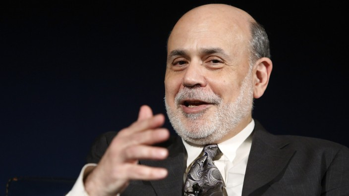 Bernanke sits for an onstage interview at the National Economists Club annual dinner at the U.S. Chamber of Commerce in Washington in this file photo