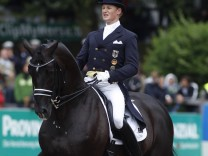 German rider Rath riding Totilas competes in the Grand Prix Freestyle Dressage Competition of the German Championships in Balve