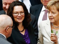 German Chancellor Merkel and Labour Minister Nahles vote on reform of Germany's pension scheme during session of lower house of parliament in Berlin
