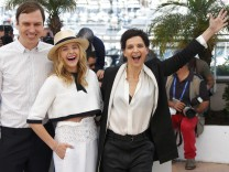 Cast members Lars Eidinger, Chloe Grace Moretz and Juliette Binoche pose during a photocall for the film 'Sils Maria' in competition at the 67th Cannes Film Festival in Cannes