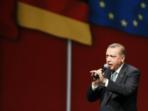 Turkish Prime Minister Erdogan speaks to supporters during his visit in Cologne