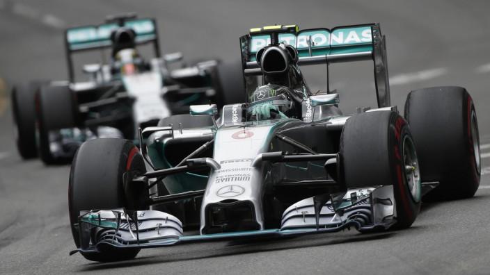 Mercedes Formula One driver Rosberg of Germany leads his teammate Hamilton of Britain during the Monaco Grand Prix in Monaco