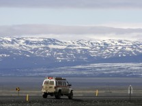 A vehicle moves on a highway near Skeidararjokull's Vatnajokull glacier