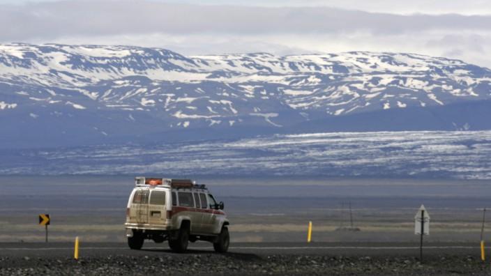 A vehicle moves on a highway near Skeidararjokull's Vatnajokull glacier