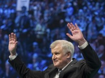 Bavarian state premier and leader of Christian Social Union (CSU) Horst Seehofer waves after his speech at the party's traditional Ash Wednesday meeting in Passau