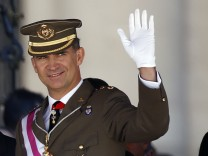 Spain's Crown Prince Felipe waves during a ceremony at the Monastery of San Lorenzo de El Escorial outside Madrid