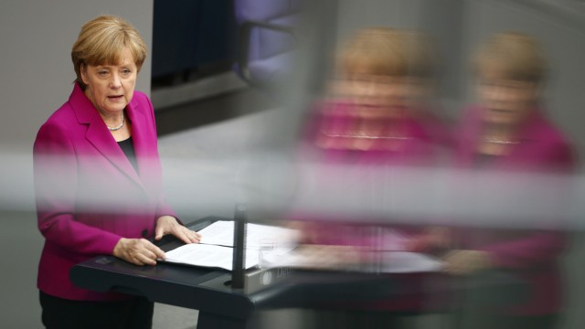 German Chancellor Merkel addresses a session of the Bundestag, the lower house of Parliament, at the Reichstag in Berlin