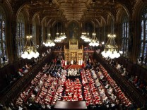 Britain's Queen Elizabeth delivers her speech in the House of Lords, during the State Opening of Parliament at the Palace of Westminster in London