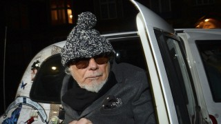 File photograph shows former British pop star Gary Glitter returning to his home in London