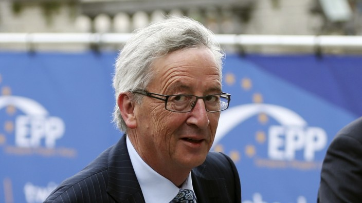 Candidate for the European Commission presidency Juncker arrives at an EPP meeting in Brussels