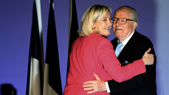 France's far right National Front party leader Marine Le Pen hugs her father Jean-Marie Le Pen, France's National Front political party founder during a campaign rally before the European Parliament elections in Marseille