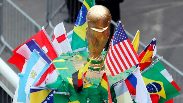 A soccer fan poses for a picture before he visits the World Cup 'Trophy Tour' in Sao Paulo