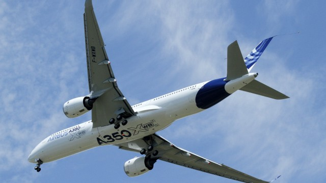 The new Airbus A350 flies over Toulouse-Blagnac airport during its maiden flight in southwestern France