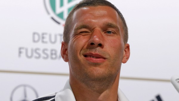 Germany's Podolski winks during a news conference in the village of Santo Andre