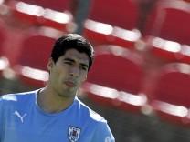 Uruguay's Suarez attends a training session at Jacare stadium in Sete Lagoas