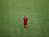 Spain's Andres Iniesta walks on the pitch during the 2014 World Cup Group B soccer match between Spain and Chile at the Maracana stadium