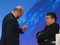 German Economy Minister Gabriel, leader of the Social Democratic Party, speaks with Schulz, top-candidate of SPD in this year's European parliamentary election, during a congress of the SPD European Parliament delegates in Berlin