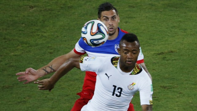 Cameron of the U.S. fights for the ball with Ghana's Ayew during their 2014 World Cup Group G soccer match at the Dunas arena in Natal