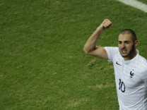 France's Karim Benzema celebrates after scoring a goal with his teammates during their 2014 World Cup Group E soccer match against Switzerland at the Fonte Nova arena in Salvador