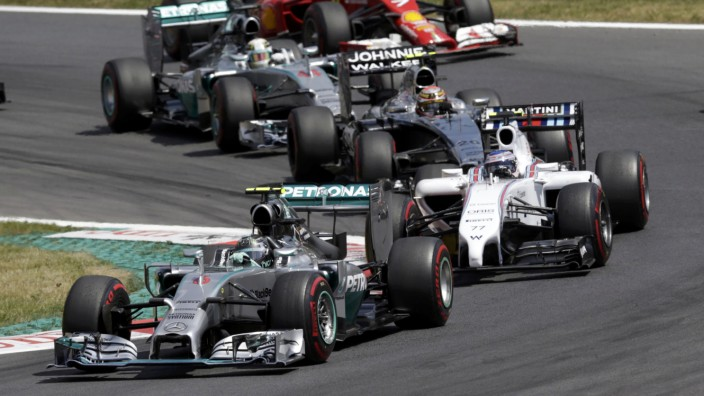 Mercedes Formula One driver Rosberg of Germany drives followed by Williams Formula One driver Bottas of Finland during the Austrian F1 Grand Prix at the Red Bull Ring circuit in Spielberg