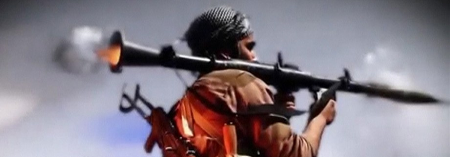 A man fires a RPG in this still image taken from an undated recruitment video for the Islamic State in Iraq and the Levant (ISIL)