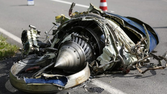 Aircraft parts are pictured on a road after a mid-air collision between two aircrafts in Elpe, near Olsberg