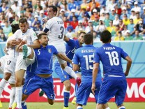 Uruguay's Diego Godin heads the ball to score a goal against Italy during their 2014 World Cup Group D soccer match at the Dunas arena in Natal