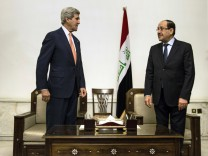 John Kerry und Nuri al-Maliki in Bagdad
