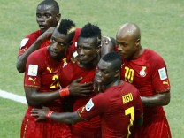 Ghana's national soccer players celebrate a goal scored by teammate Gyan against Germany during their 2014 World Cup Group G soccer match at the Castelao arena in Fortaleza