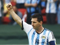 Argentina's Messi celebrates his second goal during the 2014 World Cup Group F soccer match against Nigeria at the Beira Rio stadium in Porto Alegre