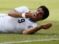 File photo of Uruguay's Luis Suarez reacting after clashing with Italy's Giorgio Chiellini during their 2014 World Cup Group D soccer match at the Dunas arena in Natal