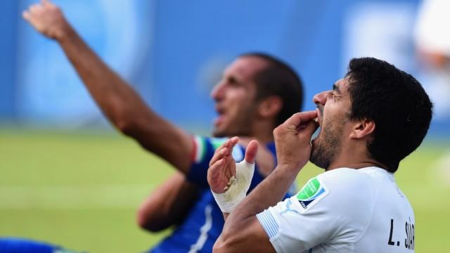 FILE: Uruguay Striker Luis Suarez Has Been Suspended For four Months