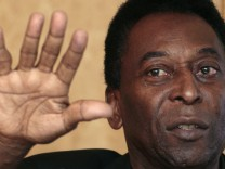 Brazilian soccer legend Pele gestures during a news conference in Hong Kong, as part of The 2011 New York Cosmos Asia Tour