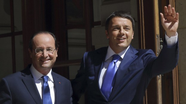 French President Francois Hollande and Italian Prime Minister Matteo Renzi arrive at the Hotel Marigny to attend a meeting of European Social-Democrat leaders in Paris