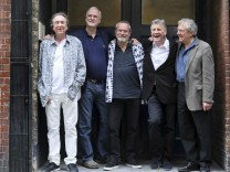 Members of British comedy troupe Monty Python pose for a photograph during a media event in central London