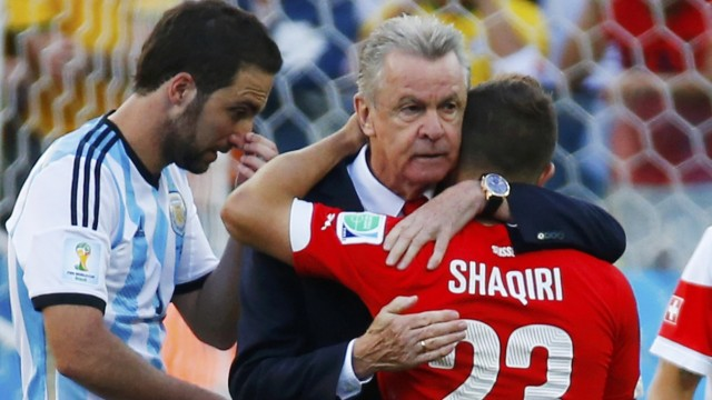 Switzerland's coach Hitzfeld embraces player Shaqiri after they were defeated in extra time in their 2014 World Cup round of 16 game against Argentina at the Corinthians arena in Sao Paulo