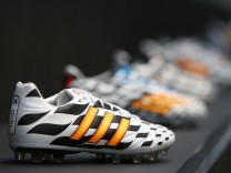 File photo of Adidas soccer shoes before company's news conference in Herzogenaurach