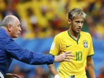 Brazil's coach Luiz Felipe Scolari gives instructions to Neymar during their 2014 World Cup Group A soccer match against Cameroon at the Brasilia national stadium in Brasilia
