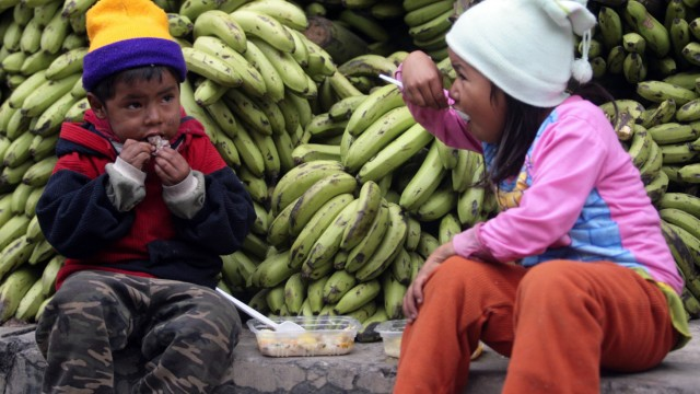 Indigenous children who live in the Isiboro Secure Territory, eat before the arrival of Bolivian President Evo Morales in La Paz