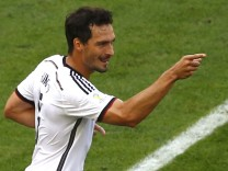 Germany's Mats Hummels celebrates after scoring a goal during the 2014 World Cup quarter-finals between France and Germany at the Maracana stadium