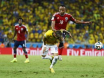 Brazil's Neymar is fouled by Colombia's Camilo Zuniga during 2014 World Cup quarter-finals at Castelao arena in Fortaleza