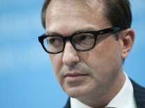 German Transport Minister Alexander Dobrindt presents plans for a road toll involving foreign drivers using the German road network, at a news conference in Berlin