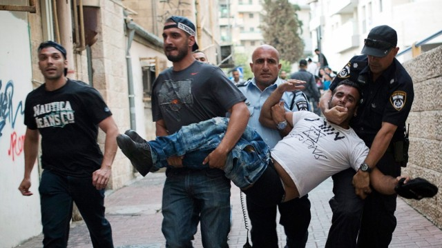 Israeli police carry away a right wing protester in Jerusalem
