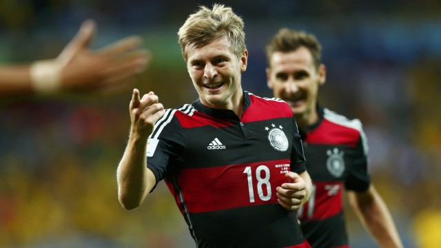 Germany's Toni Kroos celebrates after scoring his second goal during the 2014 World Cup semi-finals between Brazil and Germany at the Mineirao stadium